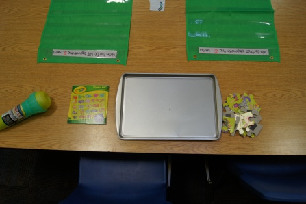 I added this ABC puzzle.  I put magnets on the back of the pieces to create a self contained activity.  I also added a microphone, from the dollar store.  When the kids were finished, they could read the ABC's into the microphone!  It was sooo cute!!