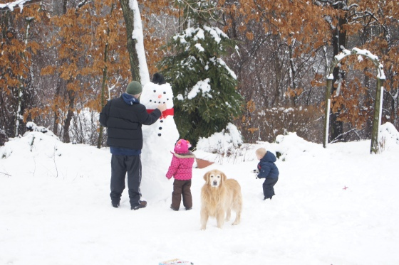 Soon we had a snowman that was over six feet tall!!
