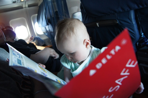 My daughter reading the safety instructions on one of her first flights.