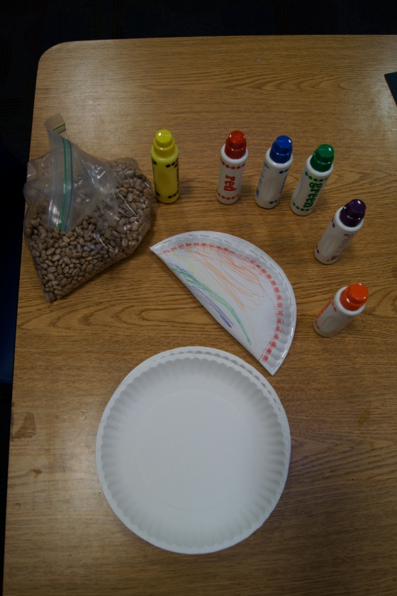 We also made musical instruments.  We took dried beans and stapled them into a paper plate.  Kids drew on the finished product and made some noise!