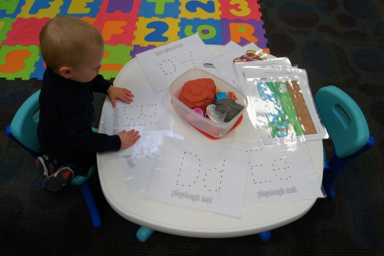 I had a play dough station that had a mat with a head on it.  The kids could create a different face displaying a feeling, create different letters, or just play away!
