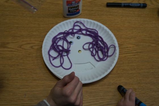 The kids decorated the top plate to look like a face.  Then they though about three different mouths that they wanted on their face.  Most of the kids made a happy, sad, and worried-looking mouth.