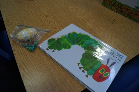 We also read The Very Hungry Caterpillar.  I had string and red and green beads.