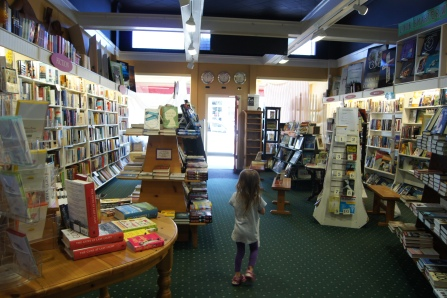 A view of the front door and part of the adult and young adult sections
