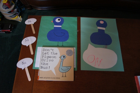 """Here is a picture of the speech bubbles that the kids held up while shouting """"No"""" to the pigeon.  Later in the class, I held one of the bubbles up and asked a child what it said and he remembered.  Great start!  In this picture is also the craft that we made based on this book.  You can find all of the instructions here.  However, with this younger group, I put a speech bubble on the page for the kids to write something that they wanted the pigeon to say."""