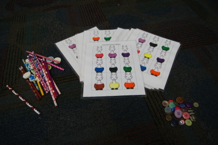 I created Colored PJ Bingo for the kids to play.  I have the printable for you here.  I had buttons (perfect for pajamas) for the kids to mark their llamas.  I also had plenty of prizes on hand.