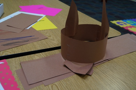 We created llama ears for the kids to wear.  All that I did is cut two ears and a long piece of brown paper.  I measured the kids heads and they were instant llamas.  They were really cute!