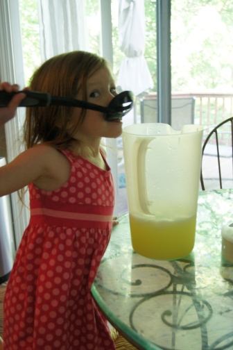 "First we made ""pretend"" lemonade from powder.  Of course there was a lot of stirring and tasting!"