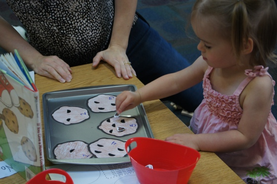"""The kids put the correct number of """"chips"""" on each cookie.  My daughter made sure that I put the cookies on a cookie sheet.  I guess it make sense!"""