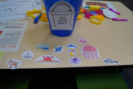 "What belongs in the ""B"" bucket?  The kids had to figure out what word began with ""B"" and put them in the bucket."