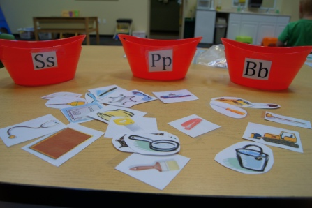 I had three bins with the letters S, P, and B on them.  I had a ton of different tools that community helpers use that begin with these letters.  The kids had to sort the tools by their beginning sound.