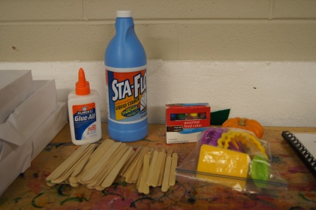Here are the supplies we used: liquid starch, school glue, and food coloring.  I had crafting sticks and other materials to create impressions.  We also needed a large bowl and something to mix the solution, we used a paintbrush.