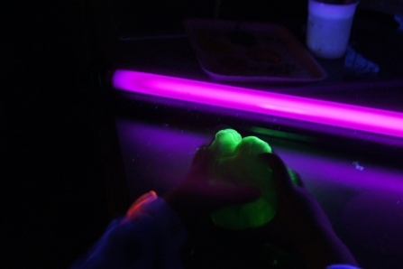 After the slime formed, we divided it up and played away!  The kids loved bringing it right up to the blacklight.  I made sure that they didn't get too close to it.