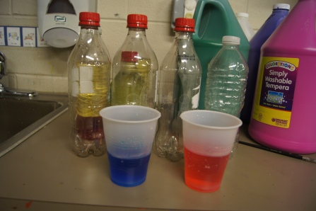 Lately, we have learned about color mixing using different mediums.  I thought that mixing blue water and red water would be a great way to introduce the concept that two liquids with the same densities mix together.  We combined the two cups and it showed us how the two different cups were not combined and mixed together.  I posed the question, do you think that all liquids mixed together like this?  We had to investigate....