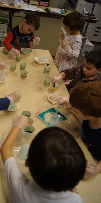 The kids got right to work!  They watched as their ice was quickly melted by the salt.